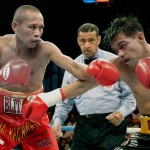 Rachman beats Kwanthai for WBA 105 lb. title