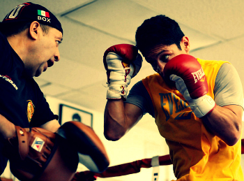 Rudy Perez(L), seen here working the mitts with Israel Vazquez(R).