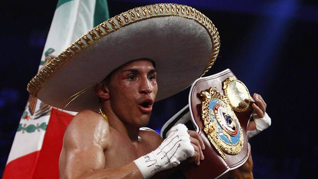 Mexico's Estrada celebrates after beating Viloria of the U.S. during their WBO/WBA World Flyweight Title match at Cotai Arena