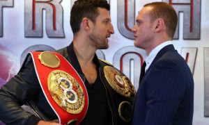 Carl Froch, holding the WBA and IBF belts, comes face-to-face with George Groves on Tuesday.