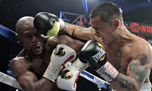 Floyd Mayweather and Marcos Maidana exchange punches in Las Vegas