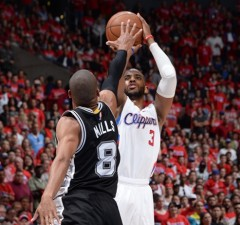 LOS ANGELES, CA - May 2:  Chris Paul #3 of the Los Angeles Clippers shoots against Patty Mills #8 of the San Antonio Spurs in Game Seven of the Western Conference Quarterfinals during the 2015 NBA Playoffs on May 2, 2015 at Staples Center in Los Angeles, California. NOTE TO USER: User expressly acknowledges and agrees that, by downloading and or using this Photograph, user is consenting to the terms and conditions of the Getty Images License Agreement. Mandatory Copyright Notice: Copyright 2015 NBAE (Photo by Andrew D. Bernstein/NBAE via Getty Images)