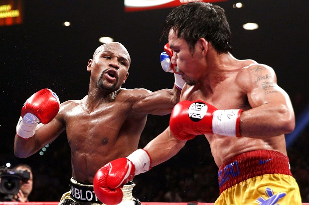 Floyd Mayweather Jr. (L) throws a left against Manny Pacquiao during their welterweight unification championship boxing fight at the MGM Grand Garden Arena in Las Vegas, Nevada, USA, on 02 May 2015.  EPA/ESTHER LIN