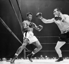 02 Jan 1957, New York, New York, USA --- 1/2/1957-New York, NY- Sugar Ray Robinson has a look of respect as he shuns a long right thrown by Gene Fullmer in the sixth round of their middleweight title go at Madison Square Garden tonight.  Fullmer, favored by the experts, added truth to their predictions by gaining a unanimous decision over Robinson. --- Image by © Bettmann/CORBIS